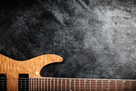 Electric guitar with natural wood finish on grey background Stock Photo