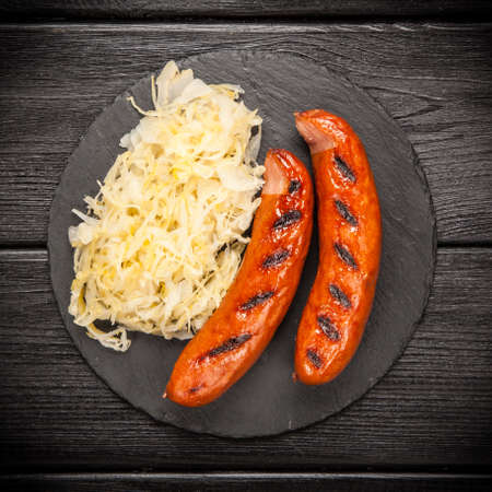 german food: Traditional german food of sauerkraut and bratwurst