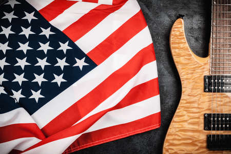 humbucker: Electric guitar and USA flag on grey background