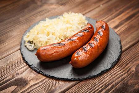 Traditional german food of sauerkraut and bratwurst