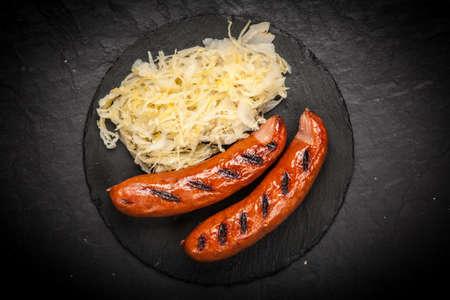 slateboard: Traditional german food of sauerkraut and bratwurst