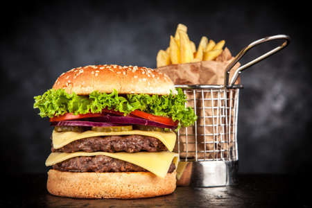 Delicious grilled burger on black background
