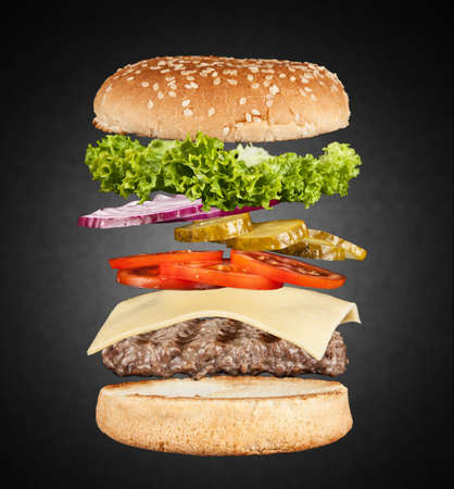 in layers: Burger layers on black background Stock Photo
