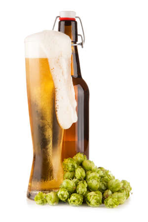 Beer glass and bottle, isolated on white background