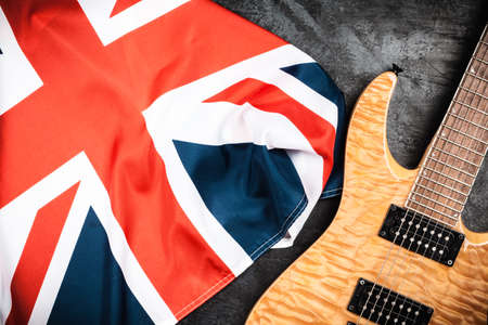 top 7: Electric guitar and British flag on grey background Stock Photo