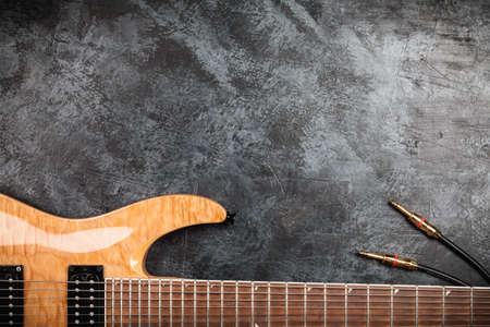 humbucker: Electric guitar with natural wood finish on grey background Stock Photo