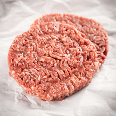 Minced beef for burgers on paper Stock Photo