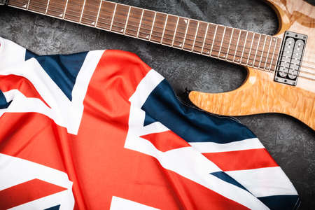 humbucker: Electric guitar and British flag on grey background Stock Photo