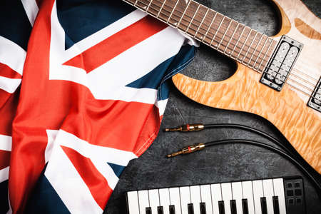 Electric guitar and British flag on grey background Stock Photo