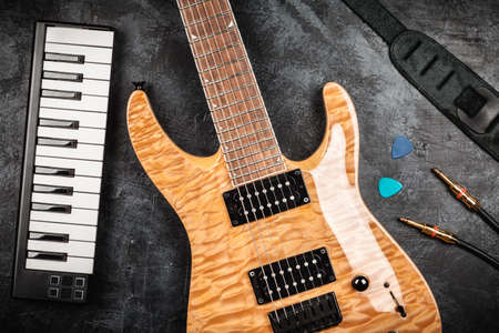 top seven: Electric guitar with natural wood finish on grey background Stock Photo