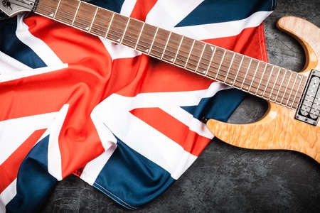 top seven: Electric guitar and British flag on grey background Stock Photo