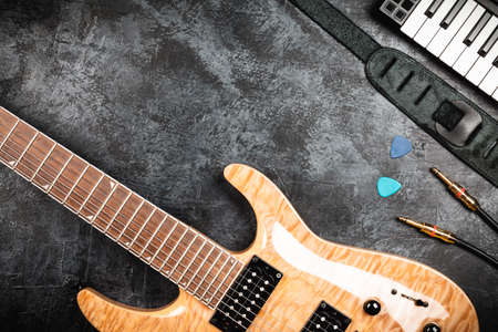 midi: Electric guitar with natural wood finish on grey background Stock Photo