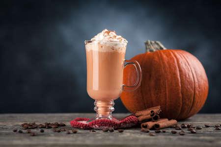 Pumpkin spice latte on dark background