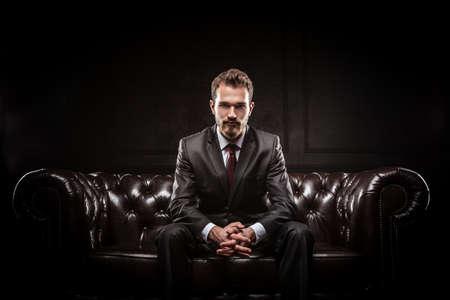 Young confident businessman in a suit Foto de archivo