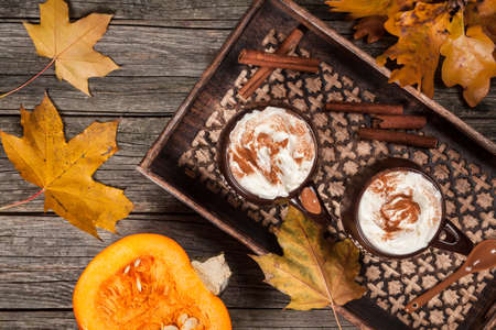 Pumpkin spice latte on a tray