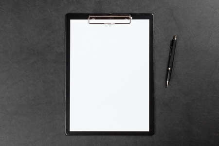 table surface: Black clipboard on leather surface table Stock Photo