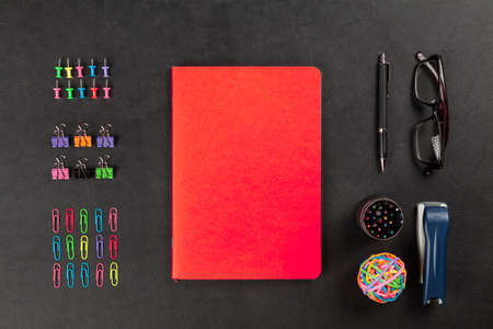 table surface: Office supplies on leather surface table
