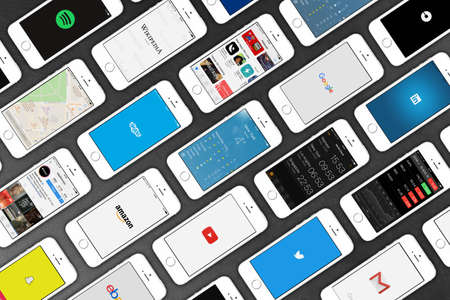 gmail: Apple iPhone 5s smartphones lying on leather surface