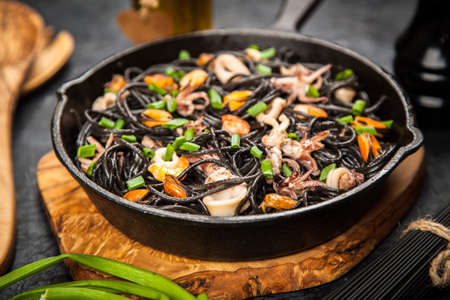Black spaghetti with seafood Stock Photo