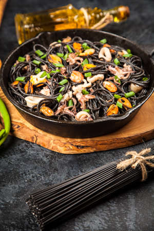 Black spaghetti with seafood Stock Photo