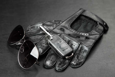 Car keys and a pair of leather driving gloves