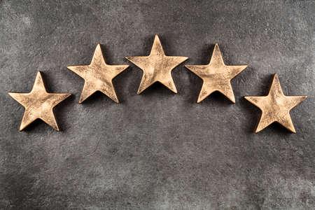 Five stars on dark background