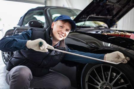 Sports car in a workshop Reklamní fotografie