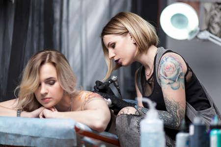 Tattoo artist in a studio