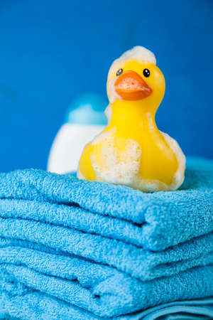 cotton bud: Soft blue towels and a toy duck