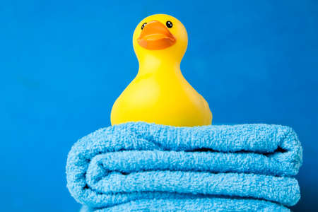Soft blue towels and a toy duck