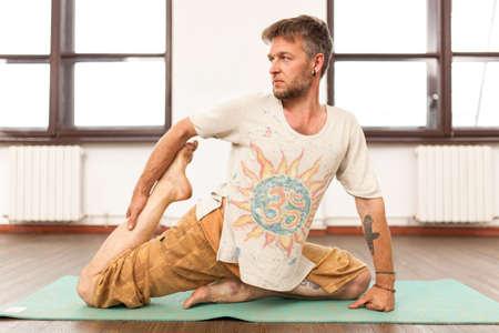 om sign: Man practicing yoga