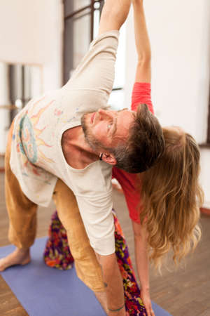 Man and woman practicing partner yoga Stock Photo