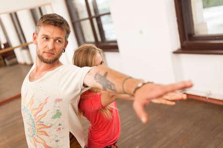 Man and woman practicing partner yoga Stock Photo