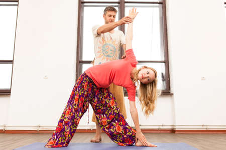 Yoga instructor teaching a woman