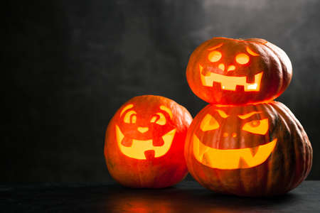 Three halloween Jack O Lantern pumpkins Stock Photo