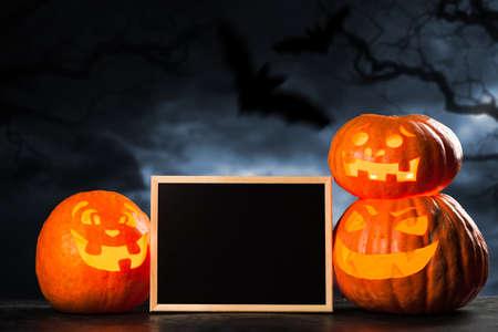 Three halloween Jack O Lantern pumpkins Stock Photo