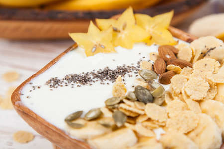 Banana yoghurt with seeds and cornflakes Stock Photo