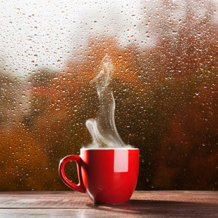 Cup of coffee on a rainy day