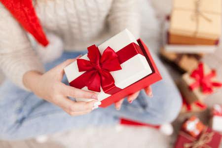 Teenage girl with Christmas presents