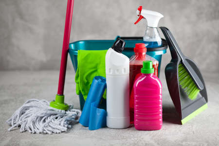 Cleaning supplies on grey background Foto de archivo