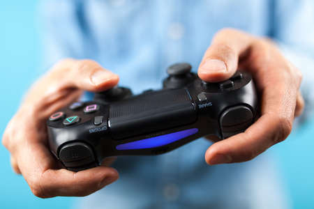 Male hands holding a PS4 controller