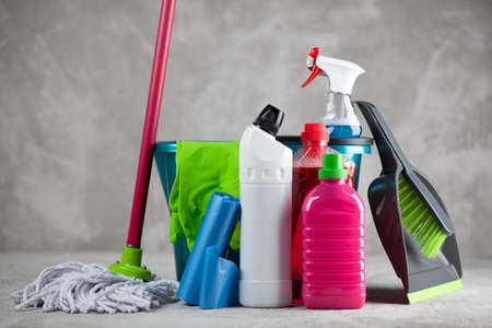 Cleaning supplies on grey background Stock Photo