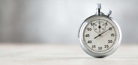 Analog stopwatch on grey background 스톡 콘텐츠