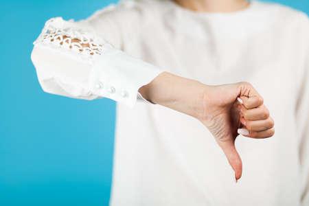Female hand on blue background