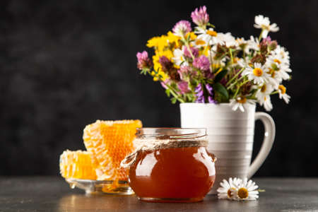 Honey jar and dipper with leaking honey