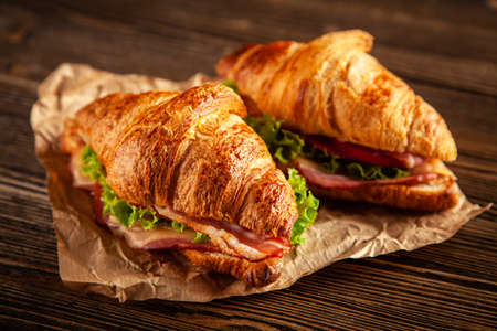 Classic BLT croissant sandwiches Foto de archivo