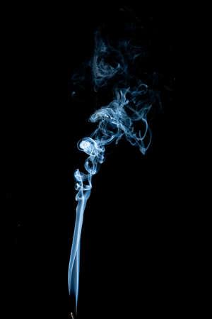 White smoke swirls on black background Фото со стока