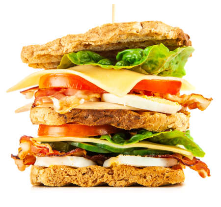 Tall club sandwich isolated on white