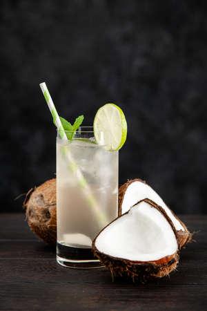 Coconut water drink on dark background