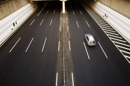 erect: A car moving through the tunnel